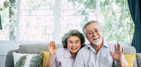 senior-couple-say-hi-look-camera-scaled
