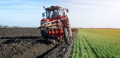 tractor-agricultural-machine-cultivating-field-scaled